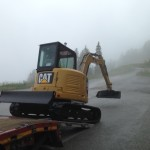 SAINTE FOY CONSTRUCTION, Builder in Savoie and its Caterpillar excavator